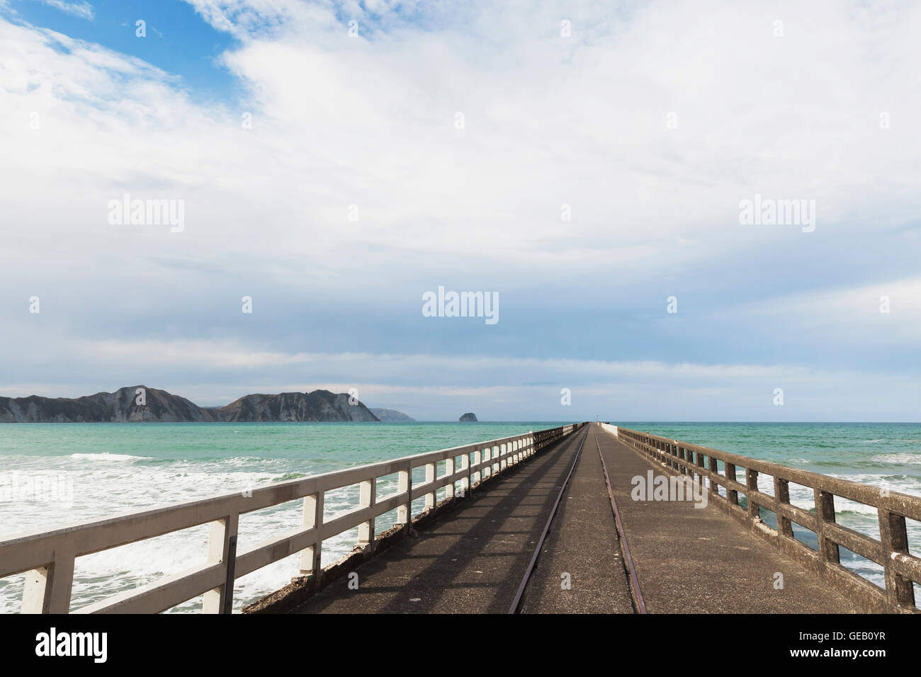 New Zealand, North Island, East Cape Region, Tolaga Bay, historic Tologa Bay Wharf, South Pacific Ocean, area of - Stock Image
