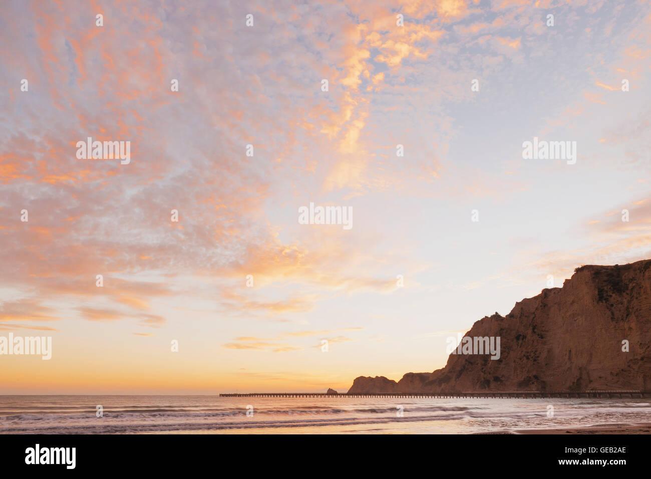 New Zealand, North Island, East Cape Region, Tolaga Bay, sunrise, historic Tologa Bay Wharf, South Pacific, area - Stock Image