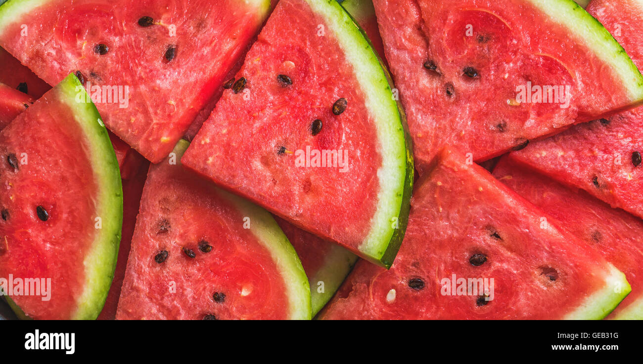 Sliced red ripe watermelon. Fruit background and texture. - Stock Image