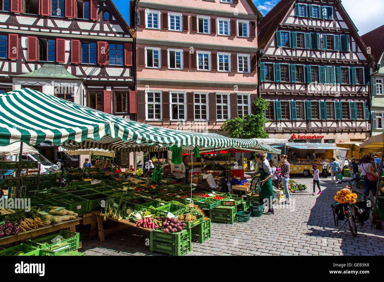 Fresh weekly farmers market on the historic market place, in the old town of Tübingen, Germany - Stock Image