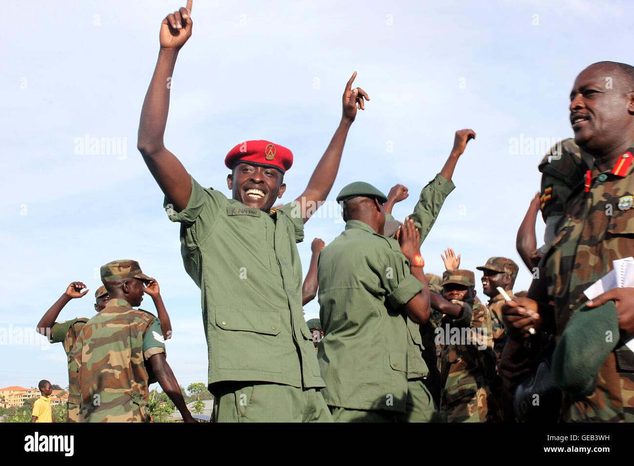 Uganda People defense Forces (UPDF) soldiers jubilate ...