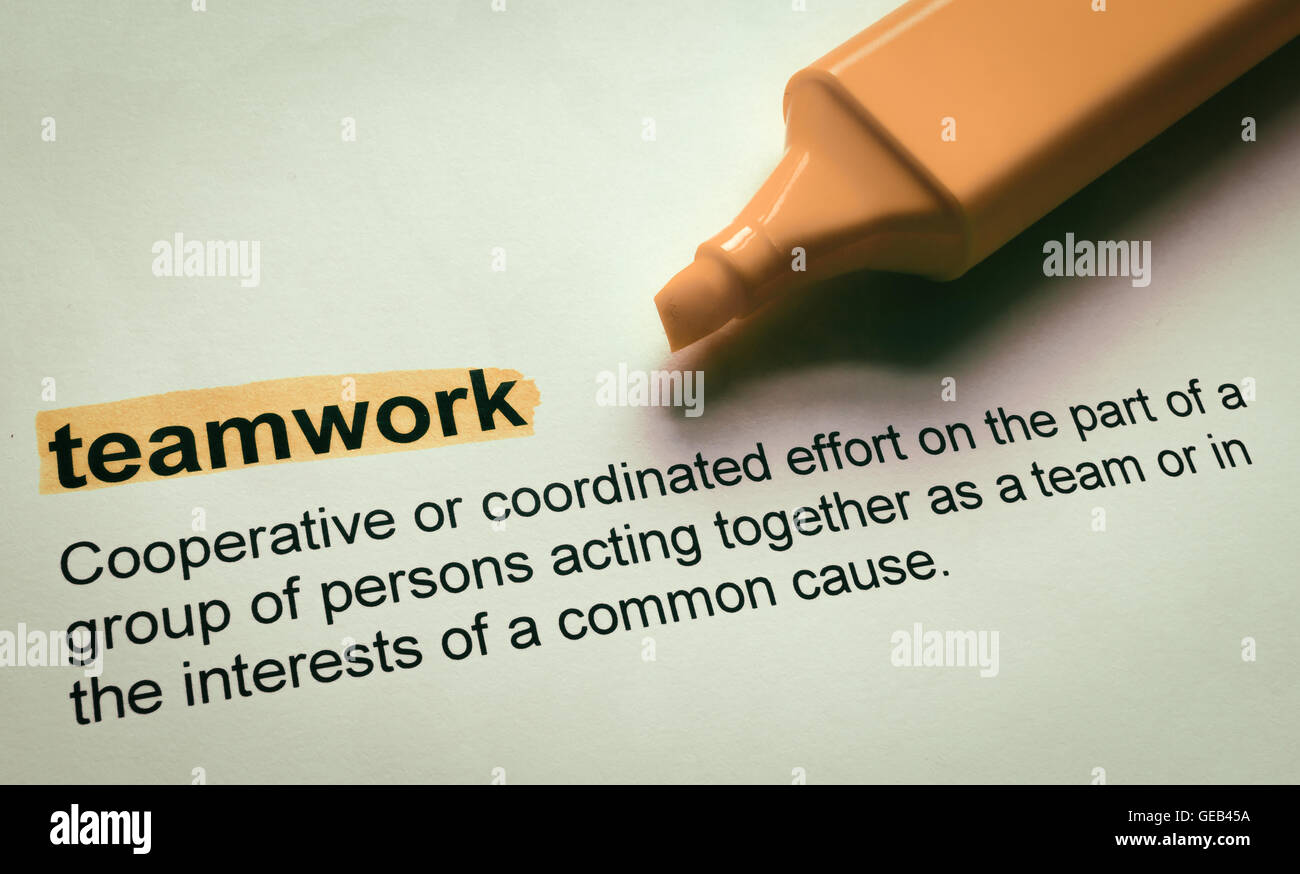 definition of teamwork, highlighted in colour stock photo: 112112150