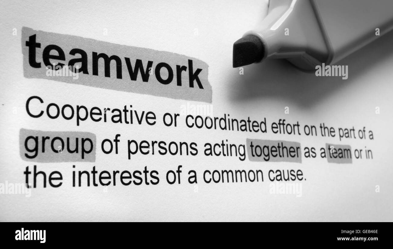 definition of teamwork, highlighted in colour stock photo: 112112182