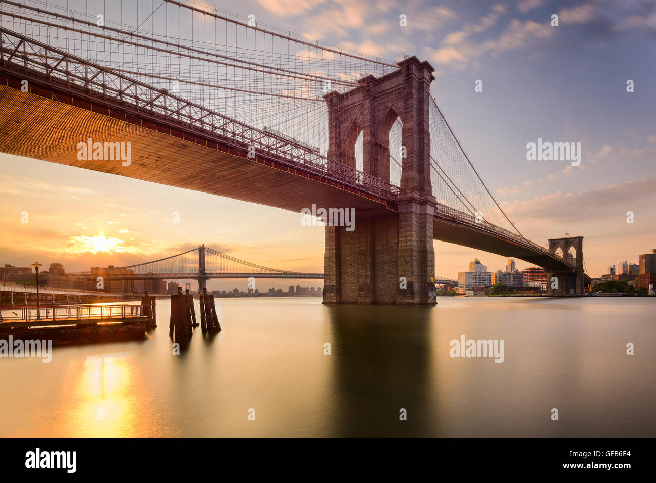 Brooklyn Bridge in New York City at sunrise. - Stock Image