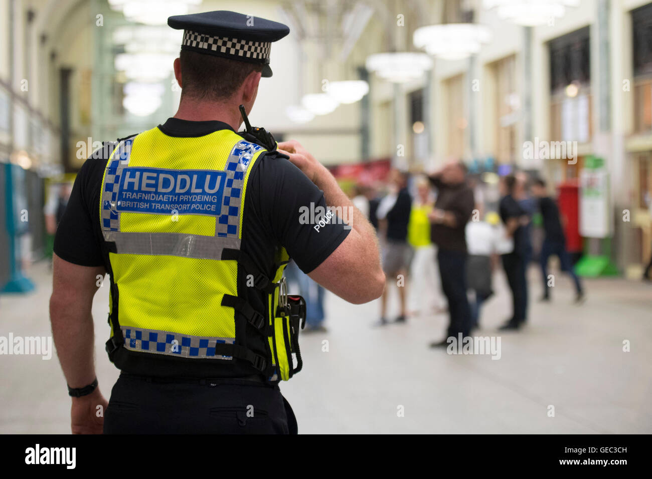 British Transport Police (BTP) at Cardiff railway train station in Cardiff, Wales, UK. - Stock Image