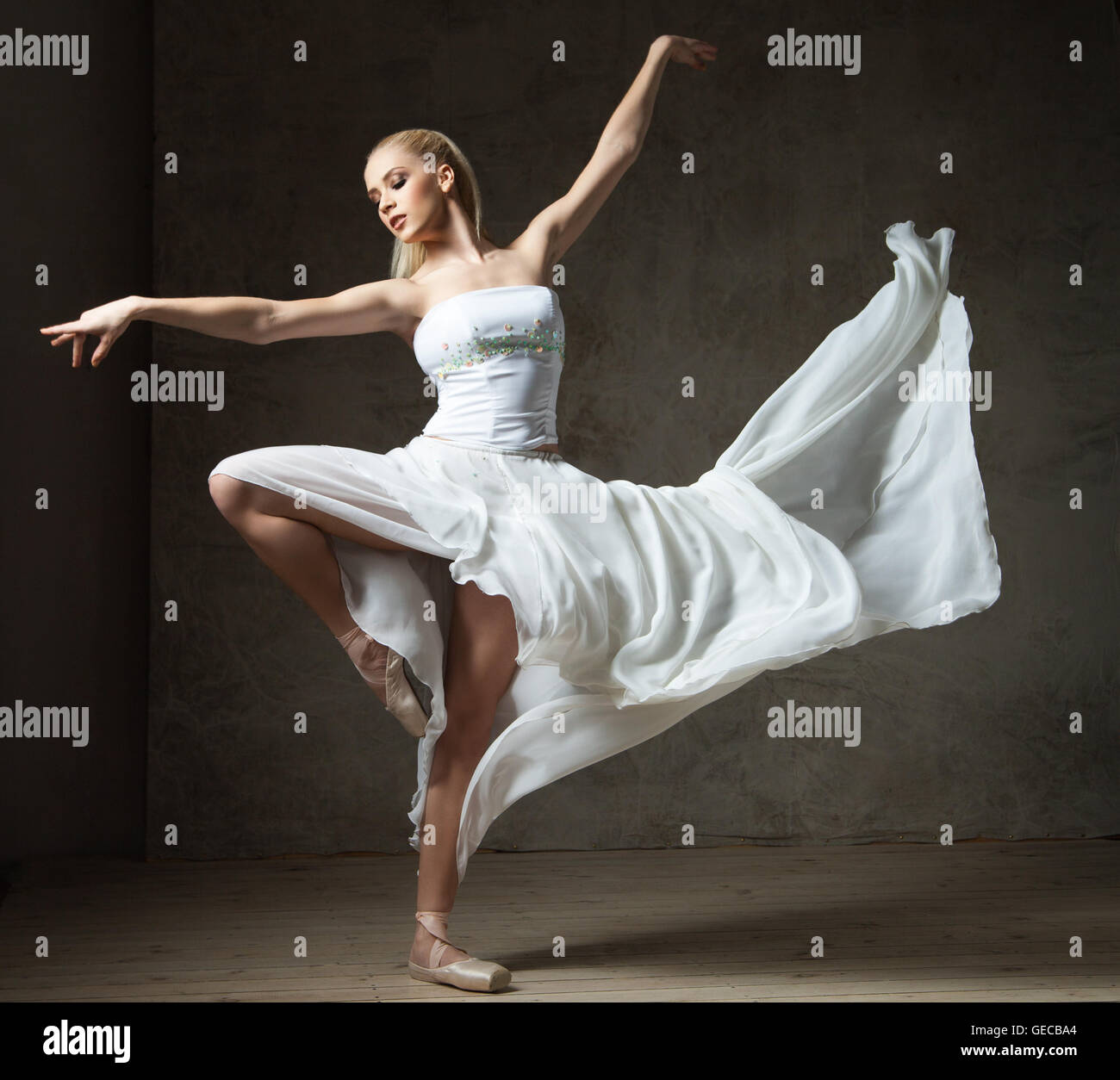 Beautiful Ballet Dancer In White Costume With Waving Skirt Dancing Stock Photo Alamy