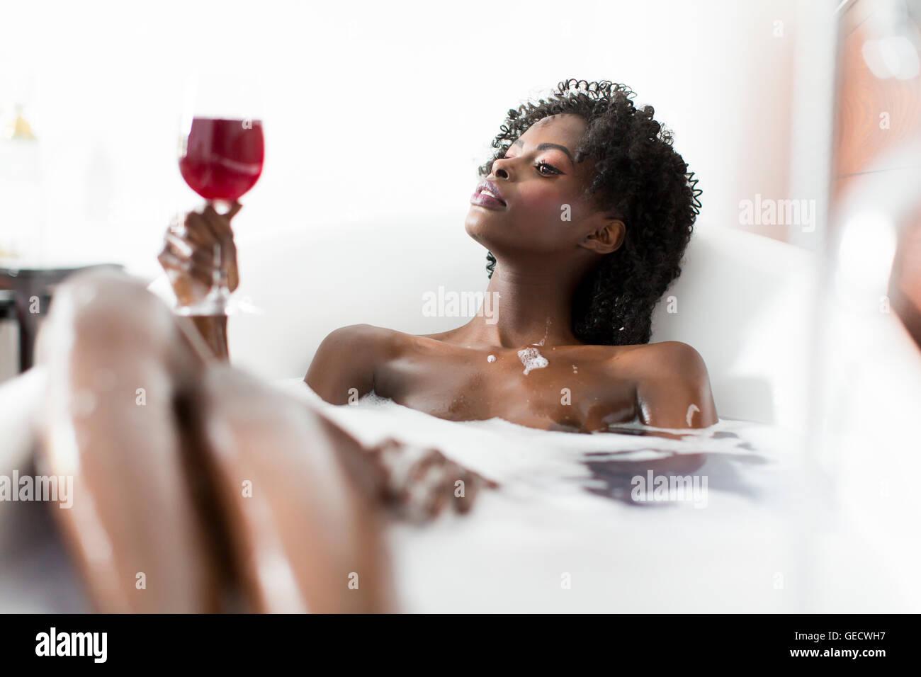 Pretty Young Black Woman Having A Foam Bath In The Room