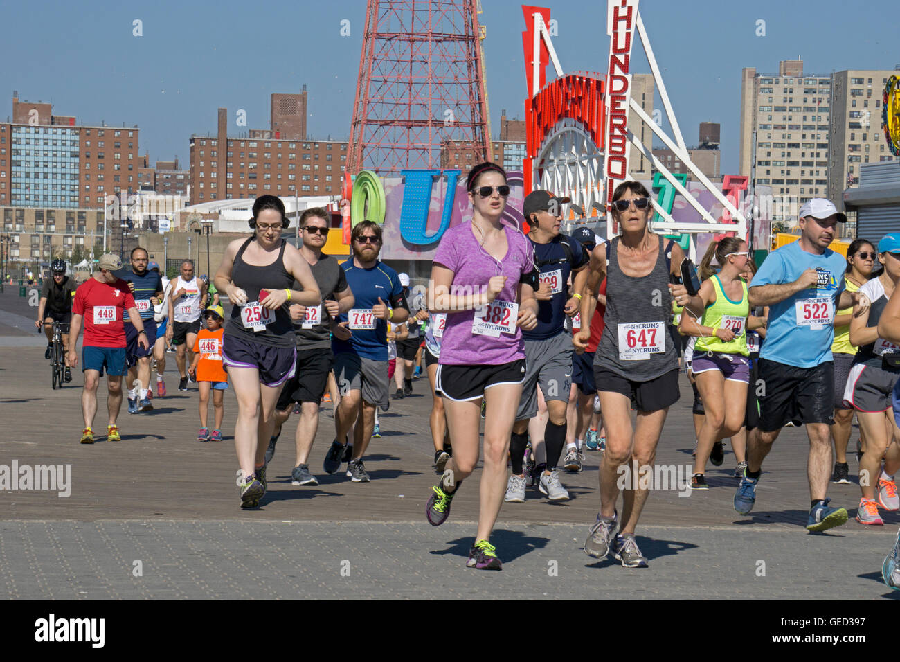 Men and women woman runners & walkers participate in the Brooklyn Cyclones 5k race in Coney Island, Brooklyn, - Stock Image