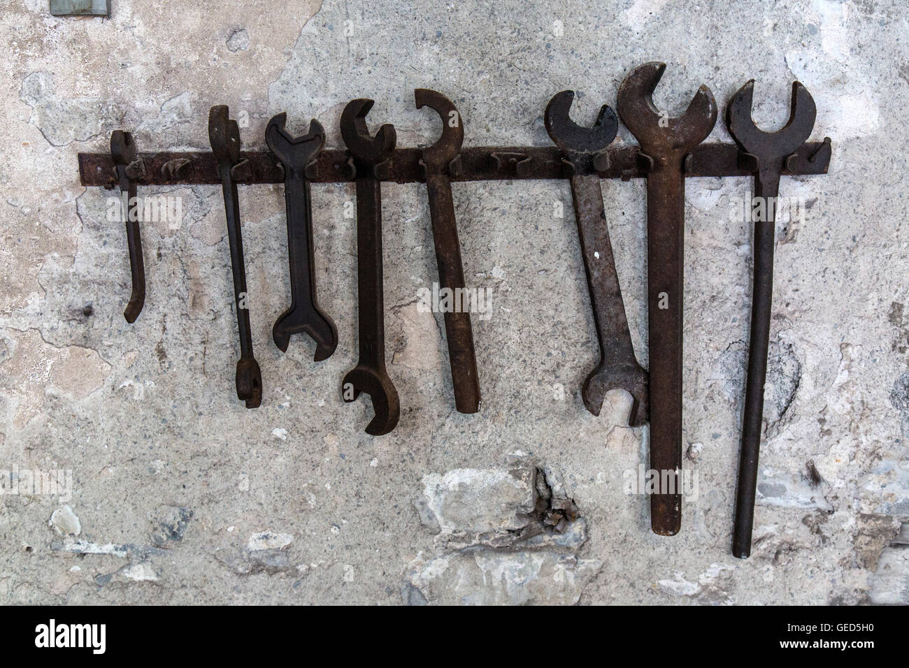 Spanners hanging on the wall inside the National Slate Museum in Llanberis, Wales. - Stock Image