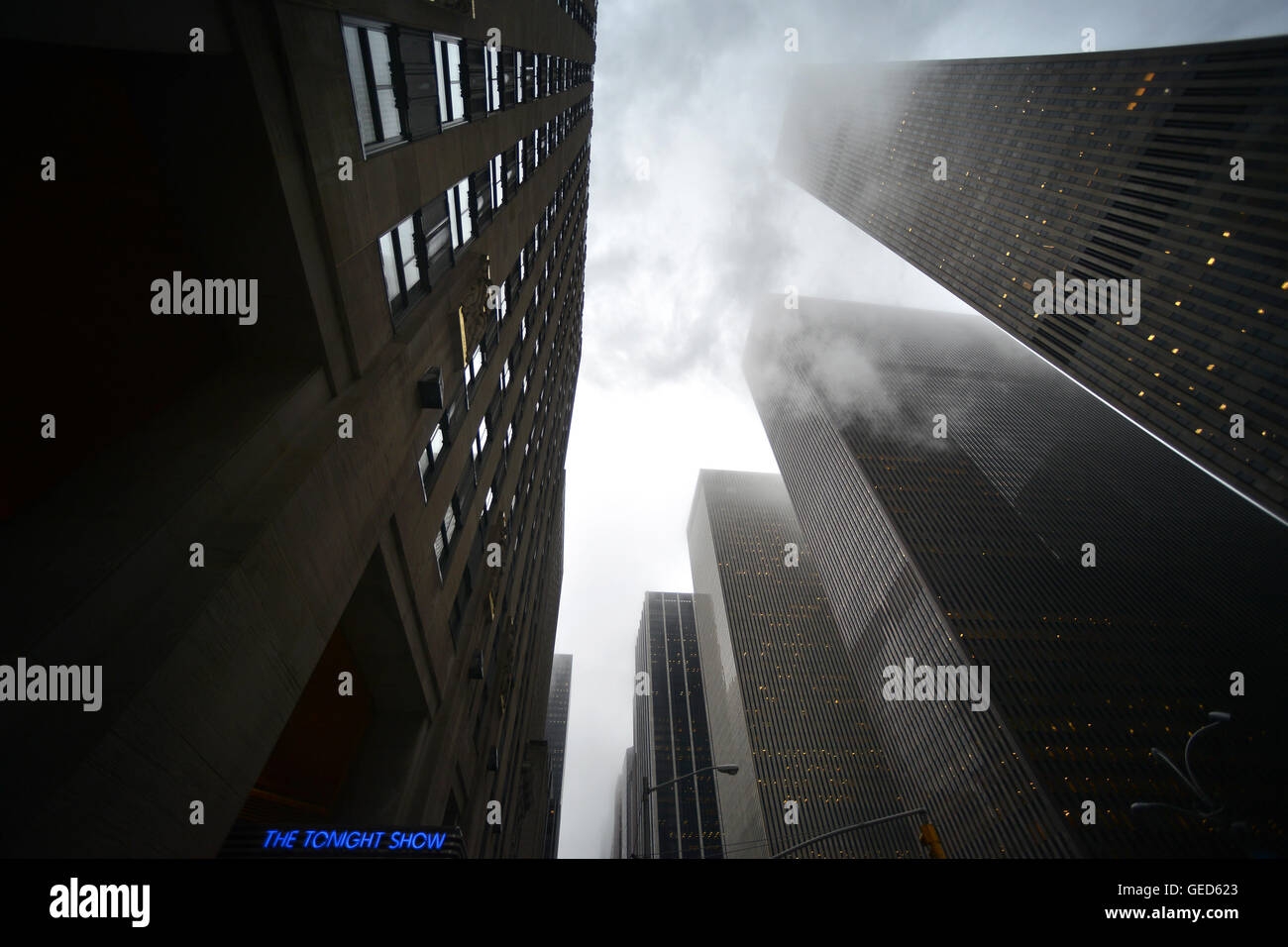 The Tonight Show sign in a bleak New York, with skyscrapers and steam - Stock Image