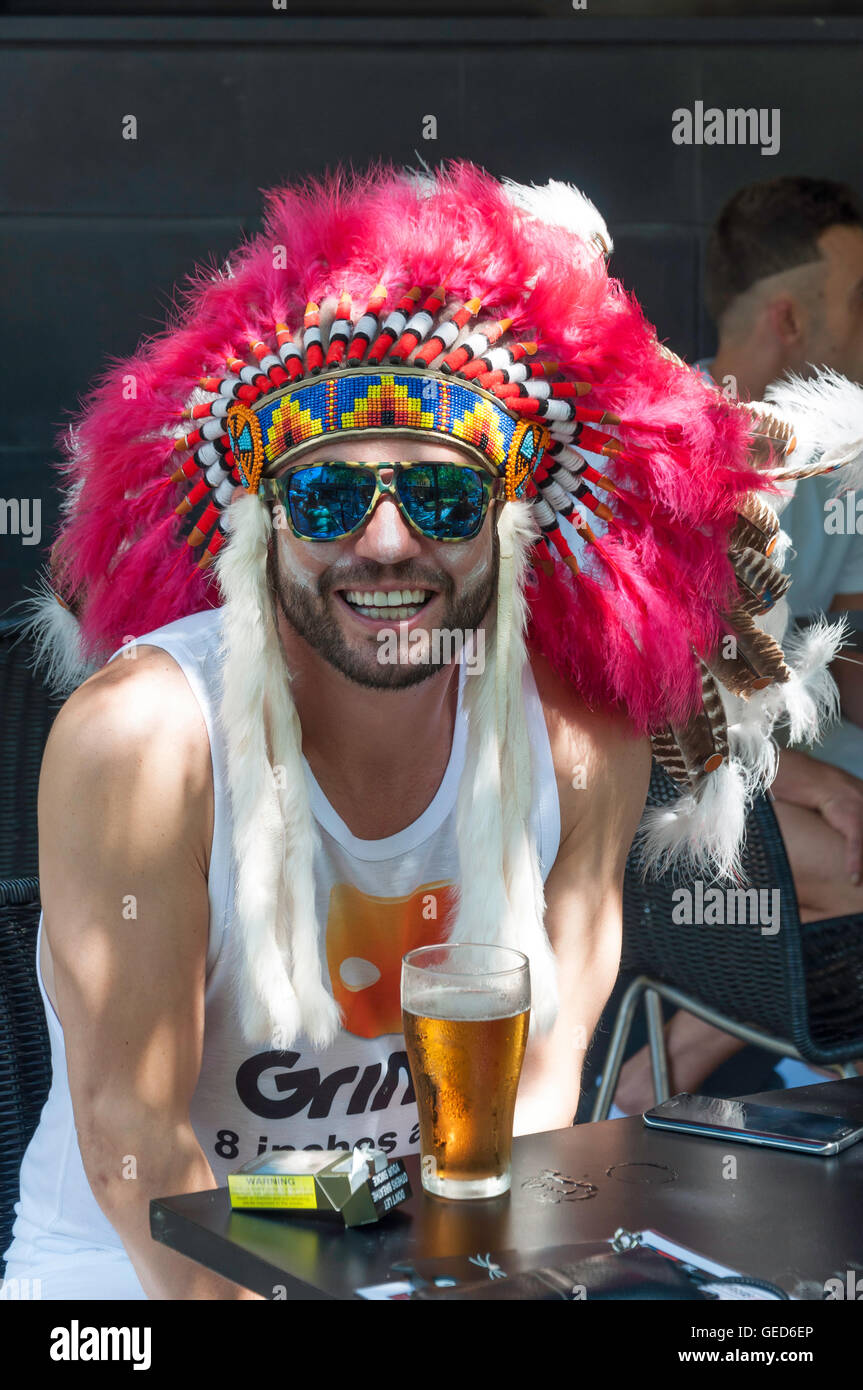 Mardi Gras reveller in street bar, Darlinghurst Road, Kings Cross, Sydney, New South Wales, Australia - Stock Image