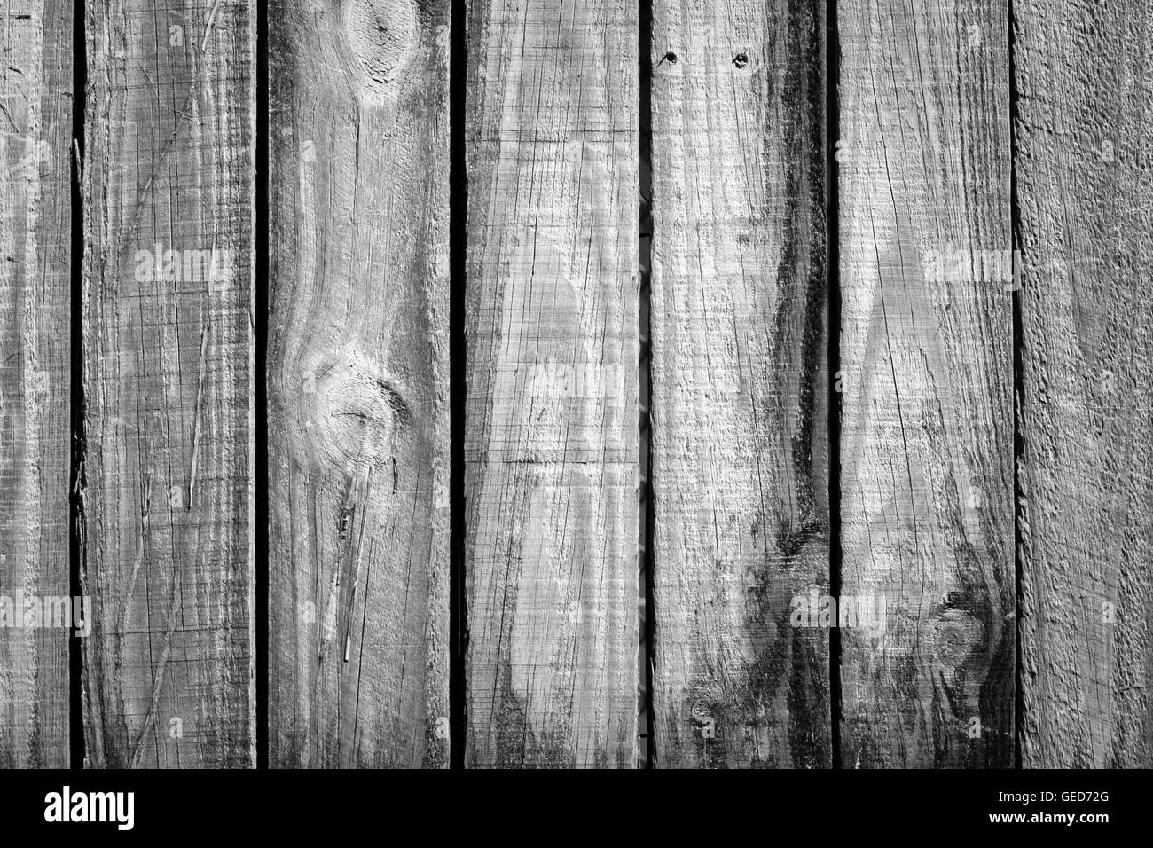 old rough timber fence planks with a old weathered look - Stock Image