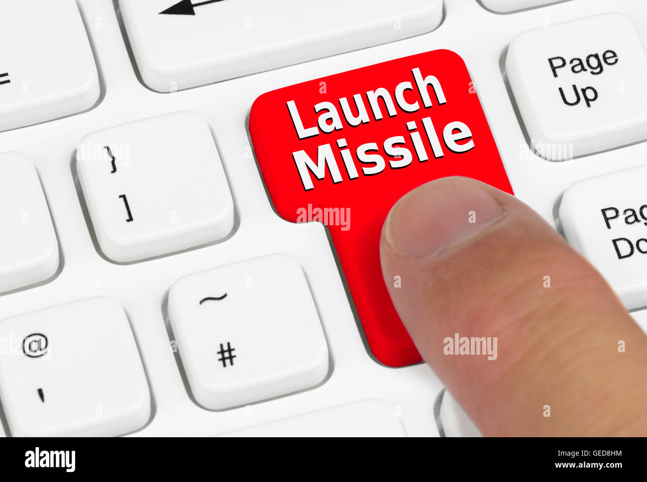 Launch missile button being pressed. - Stock Image