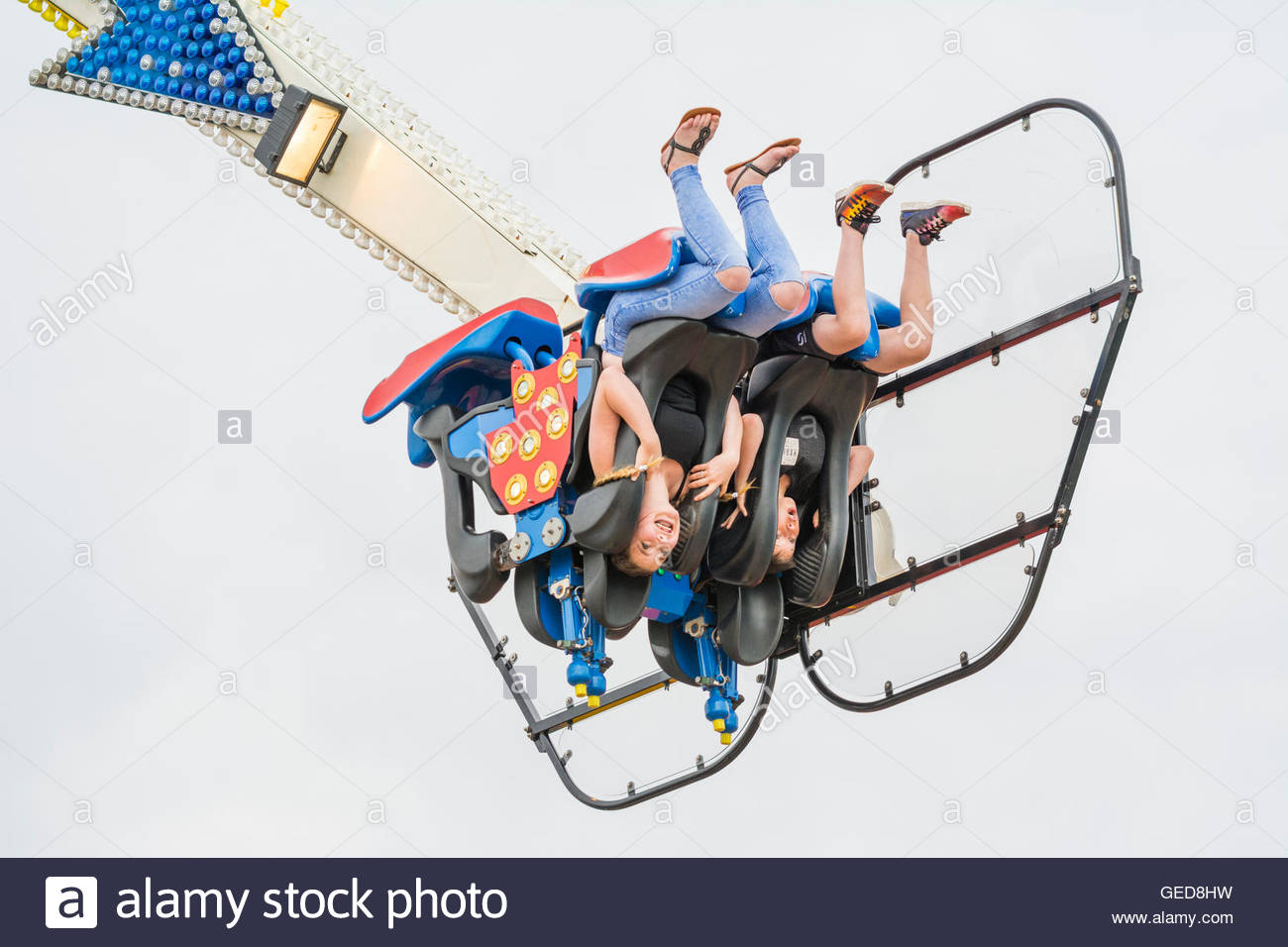 Youngsters upside-down on the Oxygen fairground ride. - Stock Image