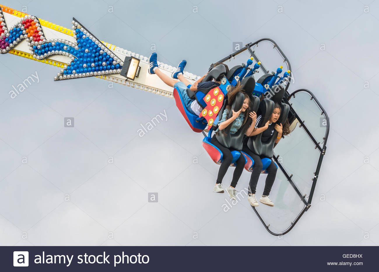 Young people riding the Oxygen funfair ride. - Stock Image