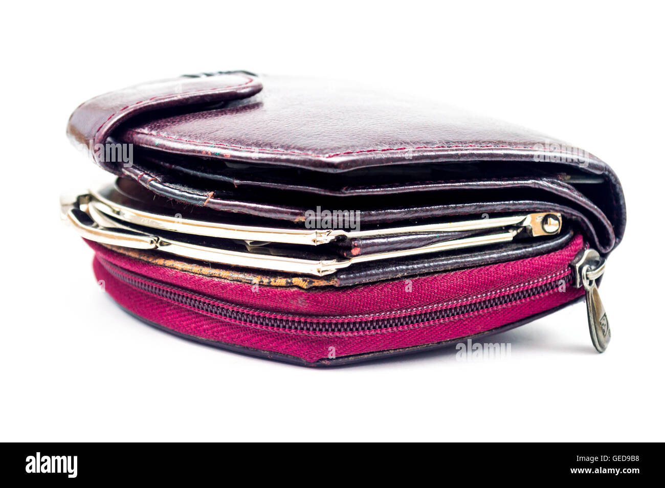 used worn out ladies leather wallets on white background - Stock Image