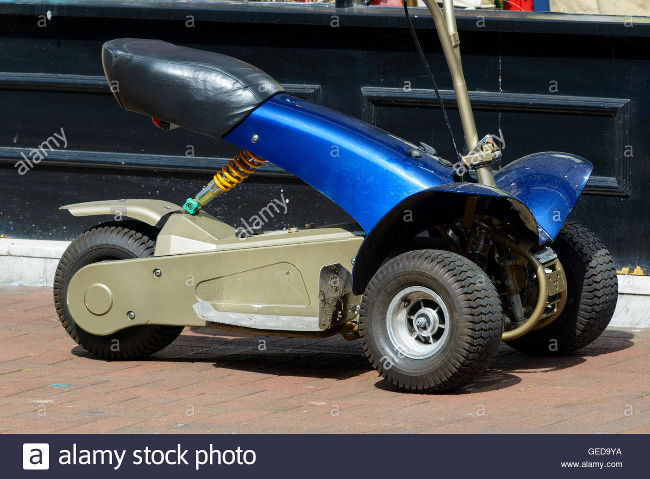 Golf buggy used as mobility scooter, Poole, Dorset, England, Britain, UK - Stock Image
