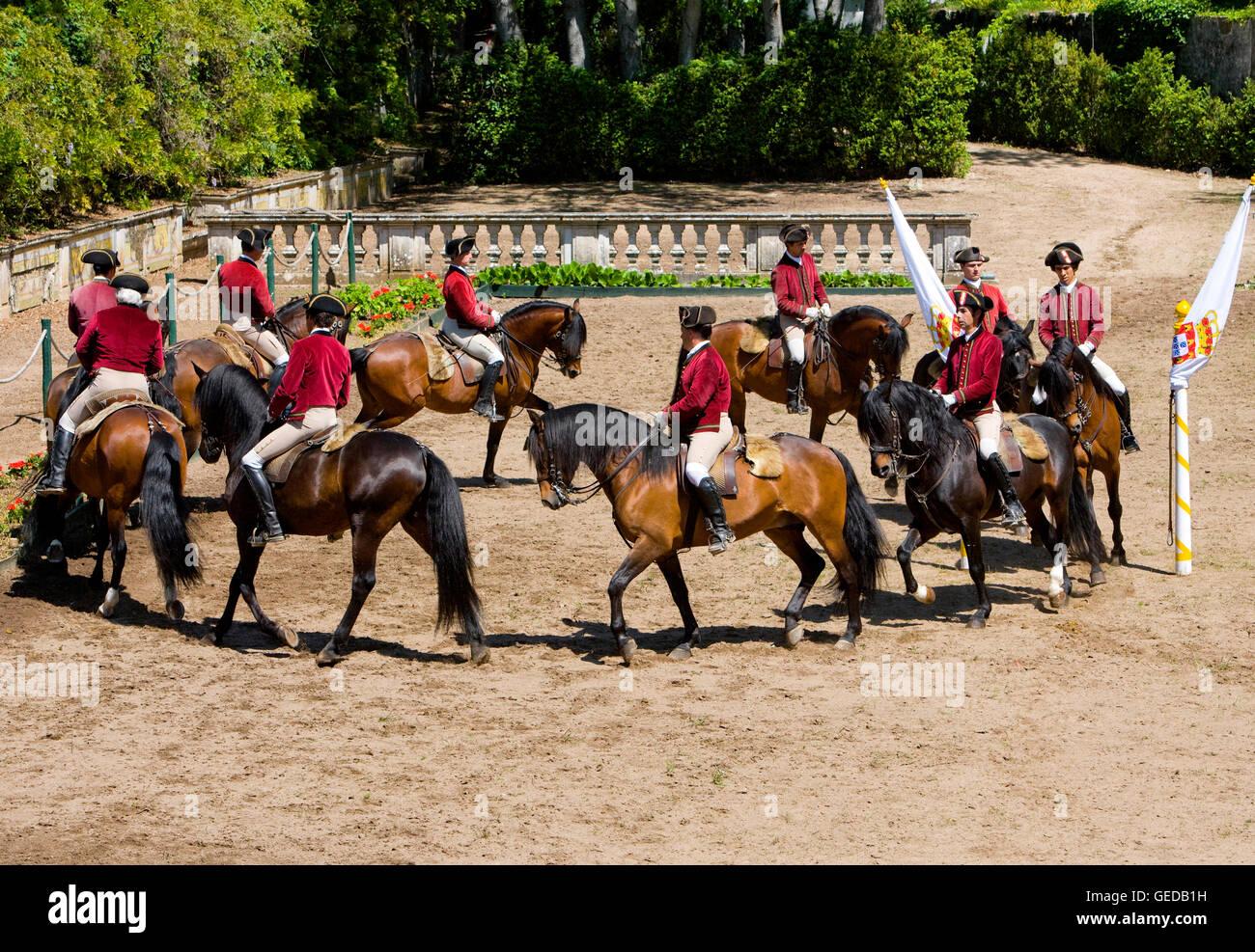 Riders of the Escola Portuguesa de Arte Equestre performing a quadrille. Queluz, Portugal. For editorial use only - Stock Image