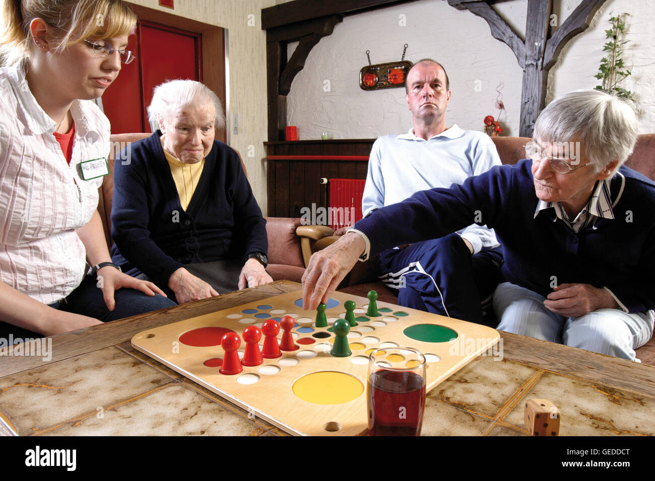 nurses and residents of an old age home or nursing home playing board stock photo 112163320 alamy. Black Bedroom Furniture Sets. Home Design Ideas