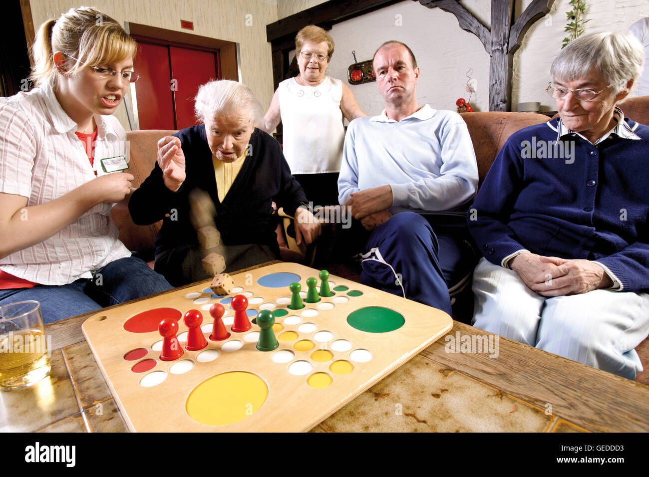 Nurses And Residents Of An Old Age Home Or Nursing Home Playing Board Stock Photo Alamy