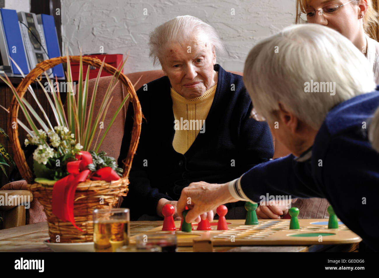 Caregiver Playing A Board Game With Two Elderly People At A Nursing Stock Photo Alamy