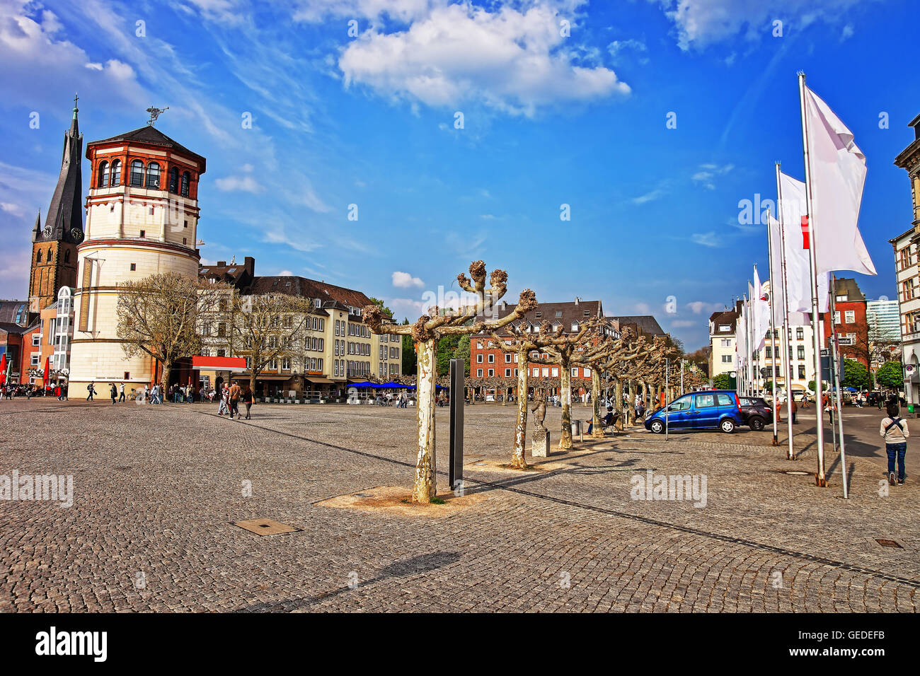 Dusseldorf, Germany - May 3, 2013: Housing and shipping museum and St Lambertus Basilica in the Old city center of Dusseldorf in Germany. Tourists nearby Stock Photo
