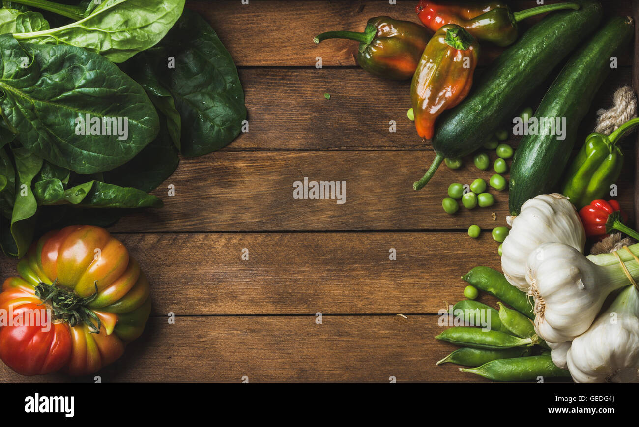 Fresh raw vegetable ingredients for healthy cooking or salad making on wooden background - Stock Image