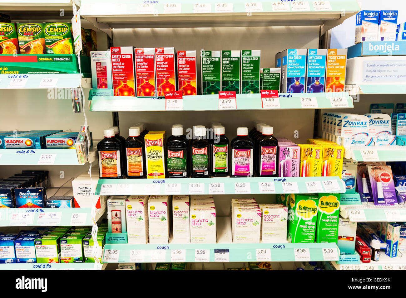 Cough medicine medicines products cough mixture Covonia brand brands types type chemist shop display UK England - Stock Image