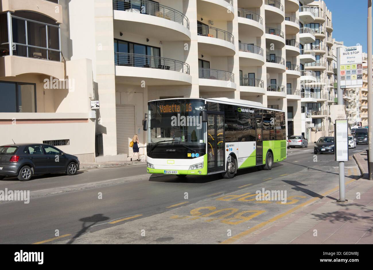 A Turkish built Otokar Vectio C bus operated by Malta Public transport passes through Sliema on route 16 to Valletta - Stock Image