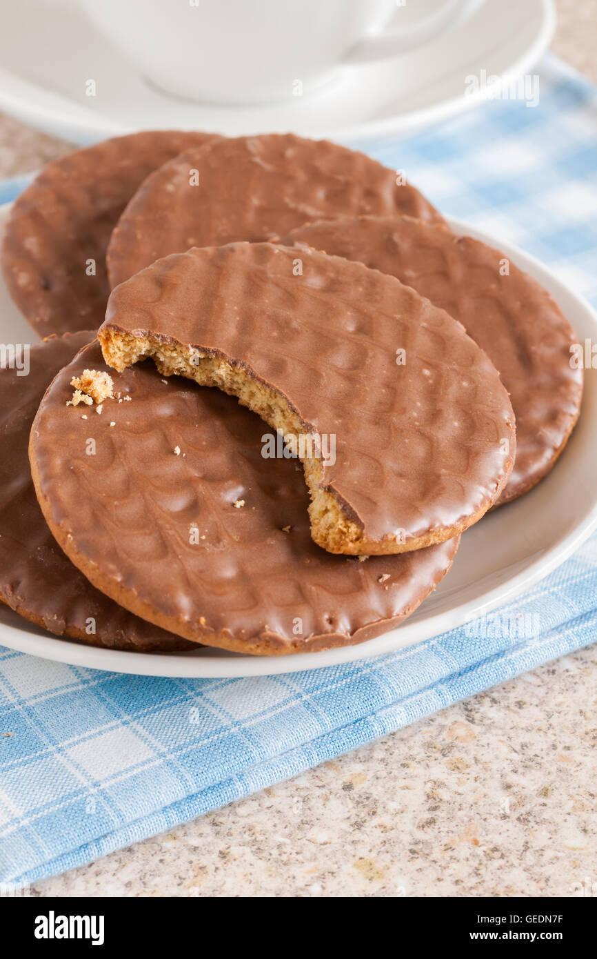 Milk chocolate covered digestive sweetmeal or wholemeal biscuits - Stock Image