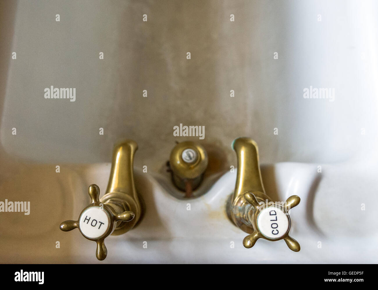 Victorian brass hot and cold water taps. - Stock Image