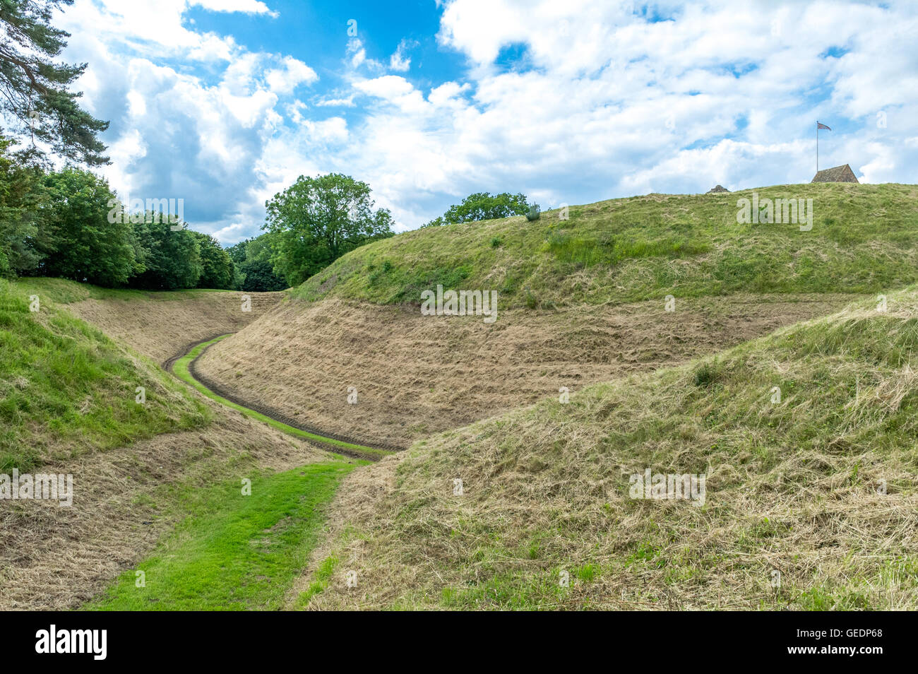 Hand dug moats at Castle Rising, Norfolk, England. - Stock Image
