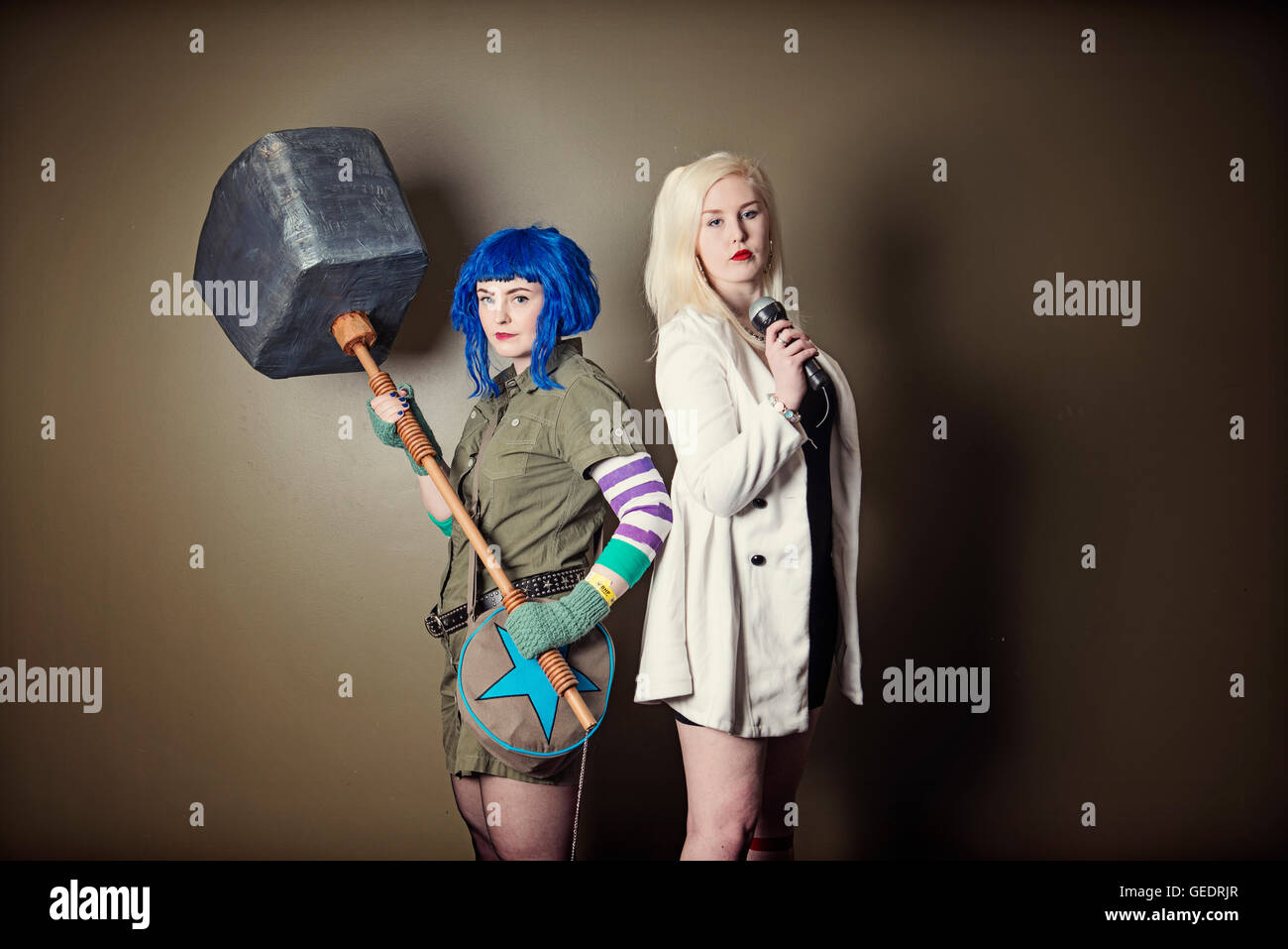 Cosplayers dressed as characteru0027s from the film Scott Pilgrim vs. the World pose for photographs at a Comic Con convention.  sc 1 st  Alamy & Cosplayers dressed as characteru0027s from the film Scott Pilgrim vs ...