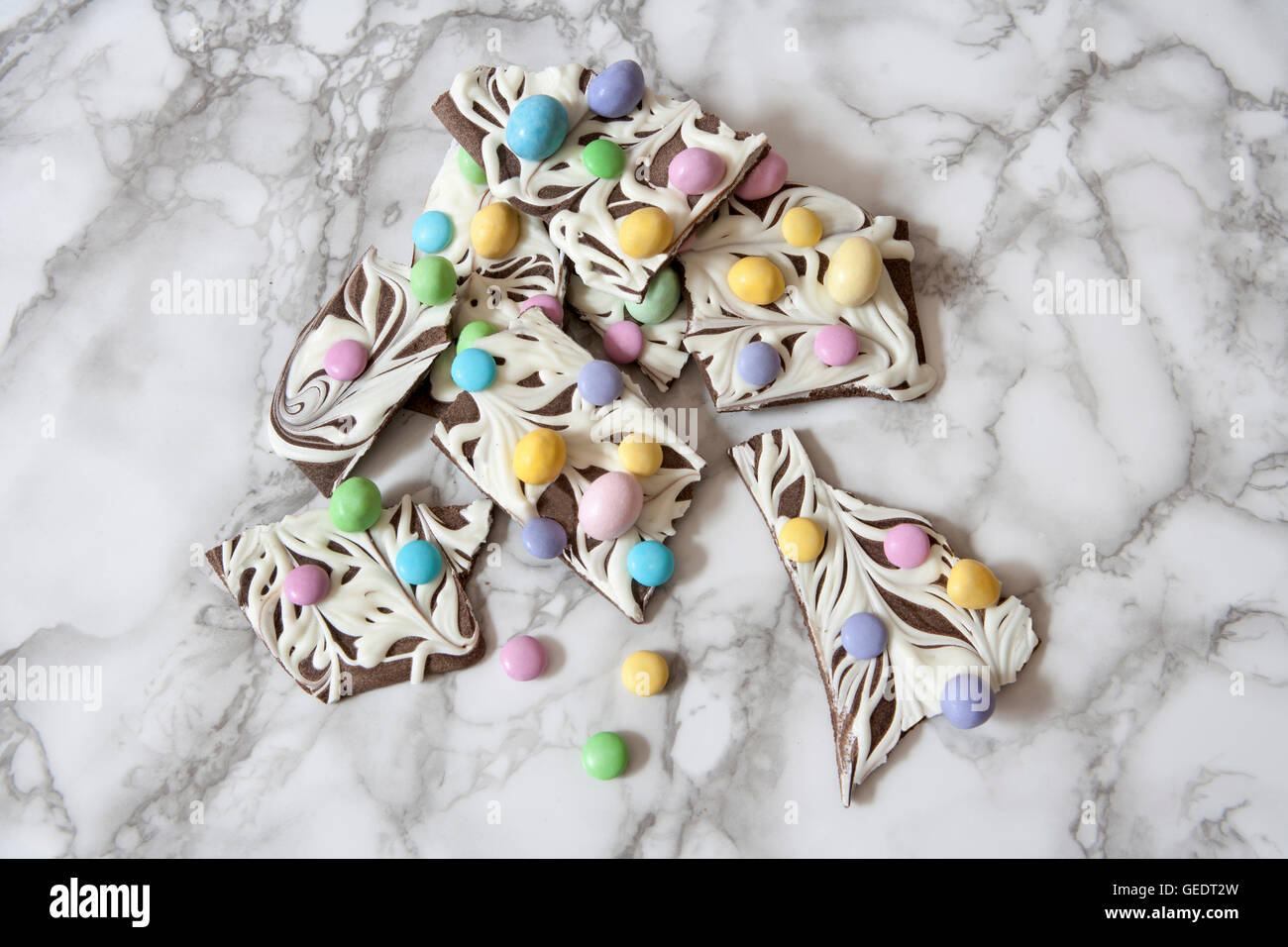 Marbled Chocolate Bark with Pastel Candies, Close-Up - Stock Image