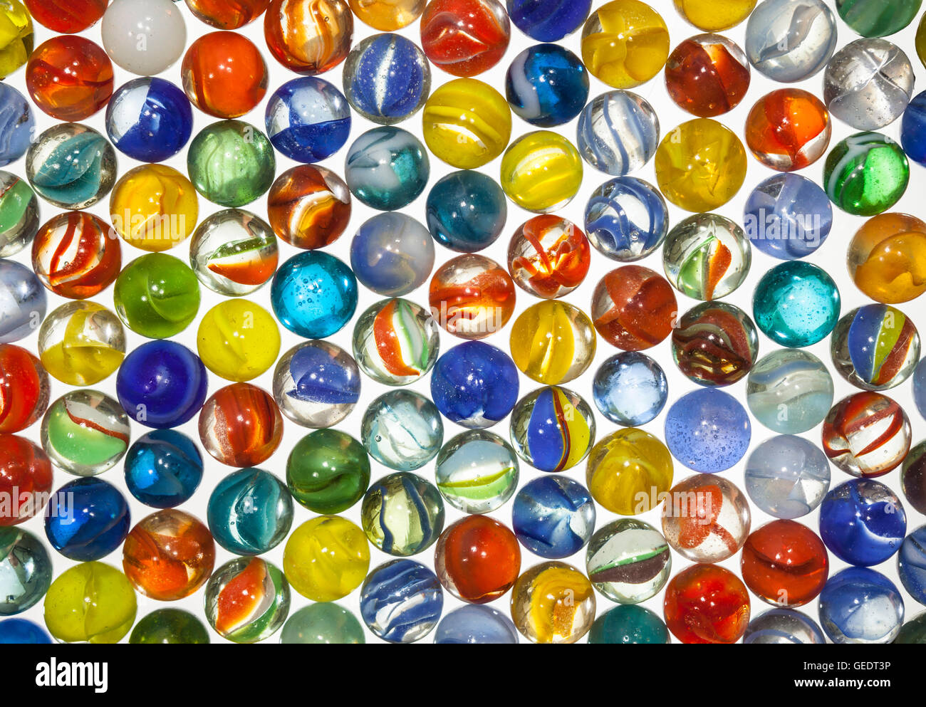 Old toy translucent marbles macro. - Stock Image