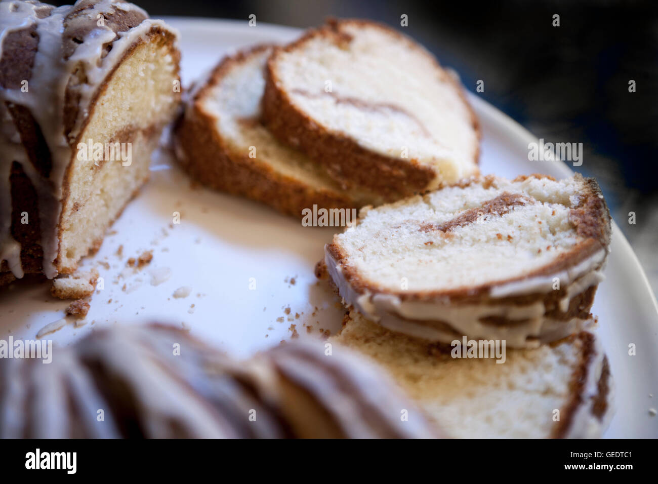 Sliced Sour Cream Coffee Cake with Maple Syrup Glaze - Stock Image