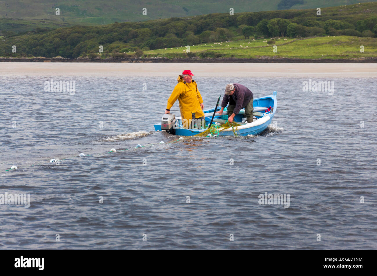Inshore draft net salmon fishermen at work in boat near Ardara, County Donegal, Ireland - Stock Image