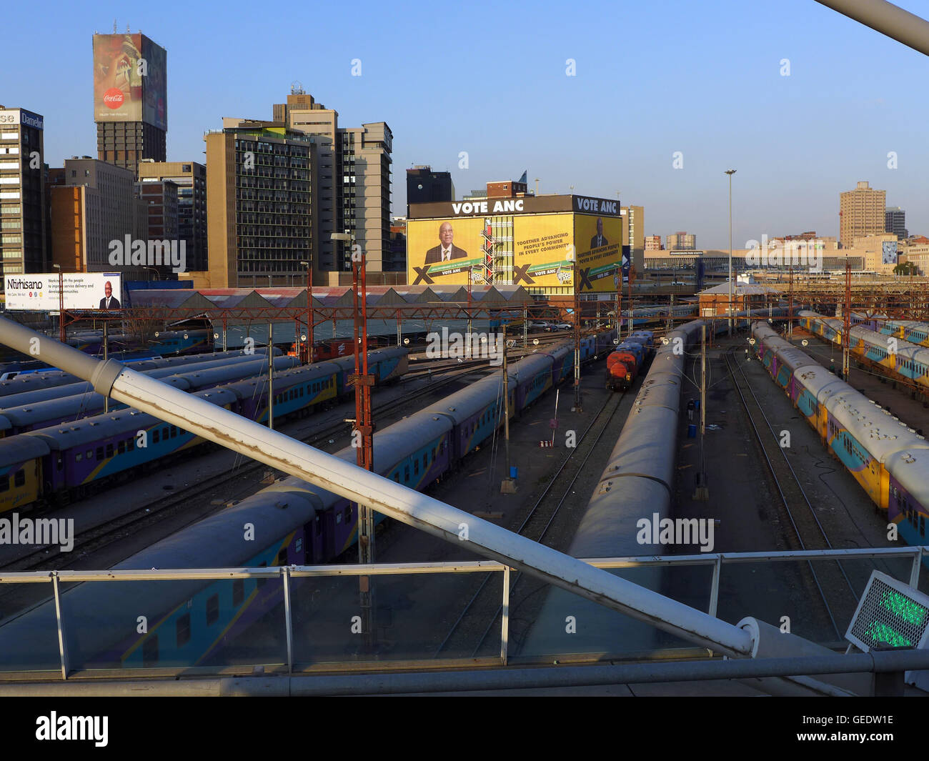 An election billboard  for the ANC and the railway yards of Johannesburg Park Station   as seen from the Nelson - Stock Image