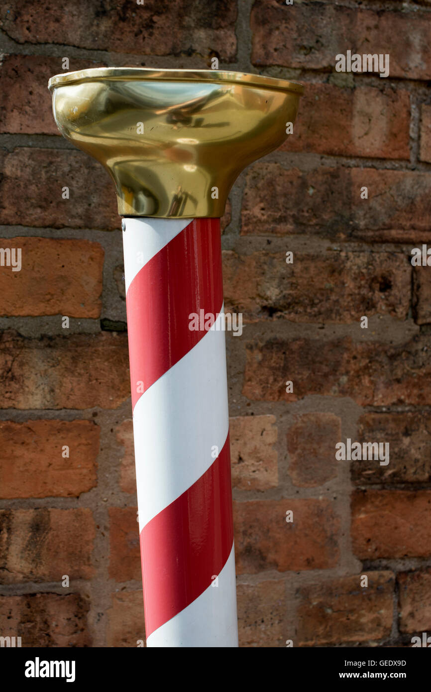 A red and white striped barber`s pole, UK - Stock Image