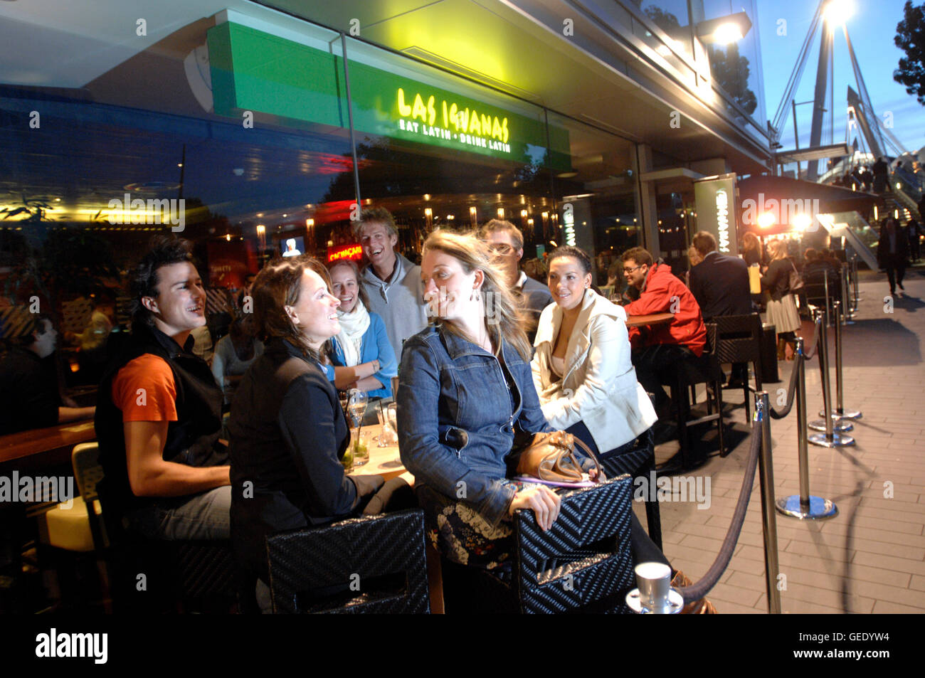 People sat outside Las Iguanas Brazilian bar, South Bank. London 2010 - Stock Image