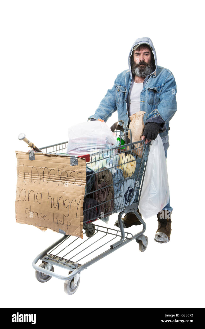 Studio shot of homeless man with beard pushing a shopping cart with all his possessions on a white background. - Stock Image