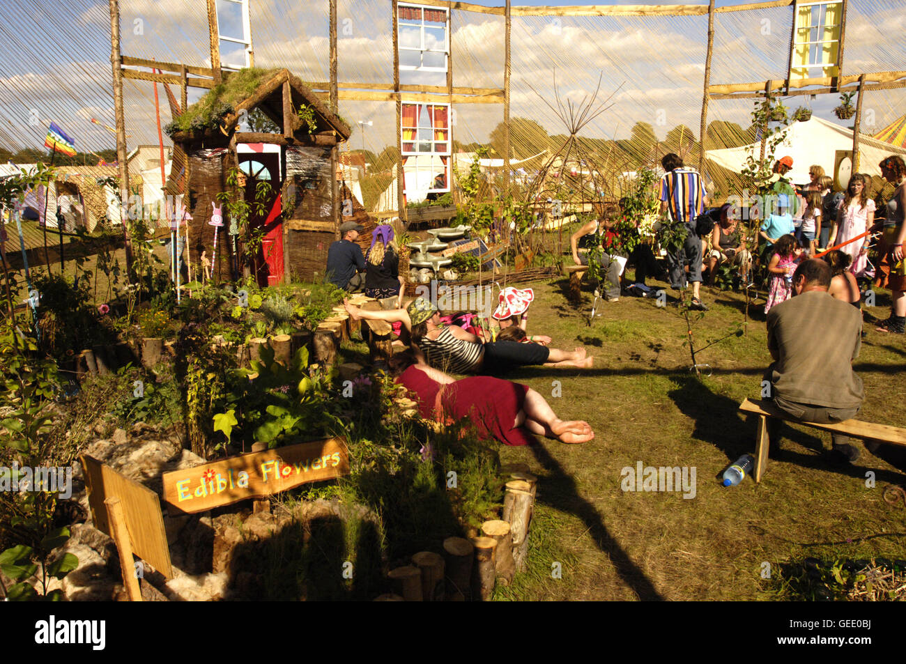 Environmentally conscious festival goers chill out in the 'permaculture' area, Big Green Gathering, UK August - Stock Image