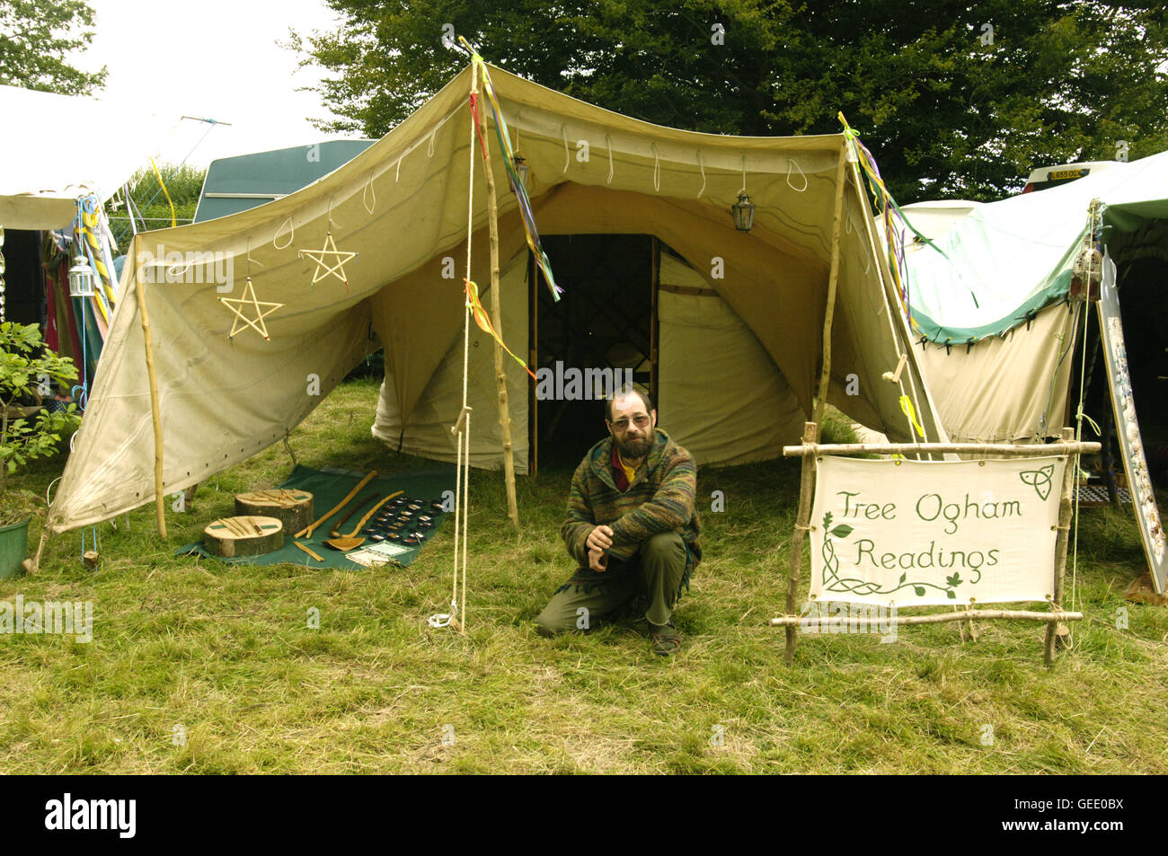 An Environmentally conscious, green fingered Ogham reader, Big Green Gathering, UK August 2005 - Stock Image