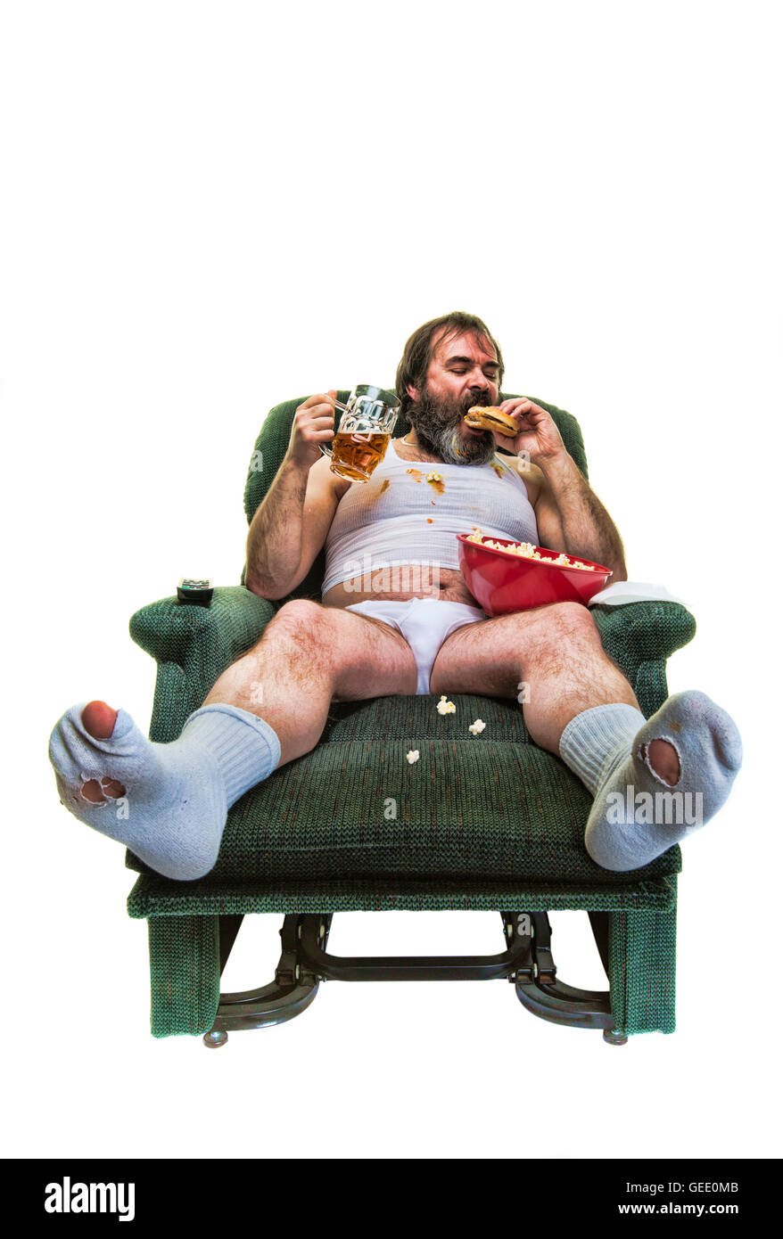 Unhealthy overweight man eating junk food on a white background. - Stock Image