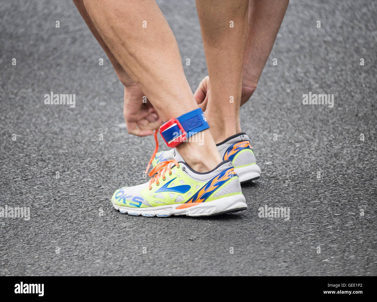Triathlete wearing timing chip/tag on ankle. - Stock Image