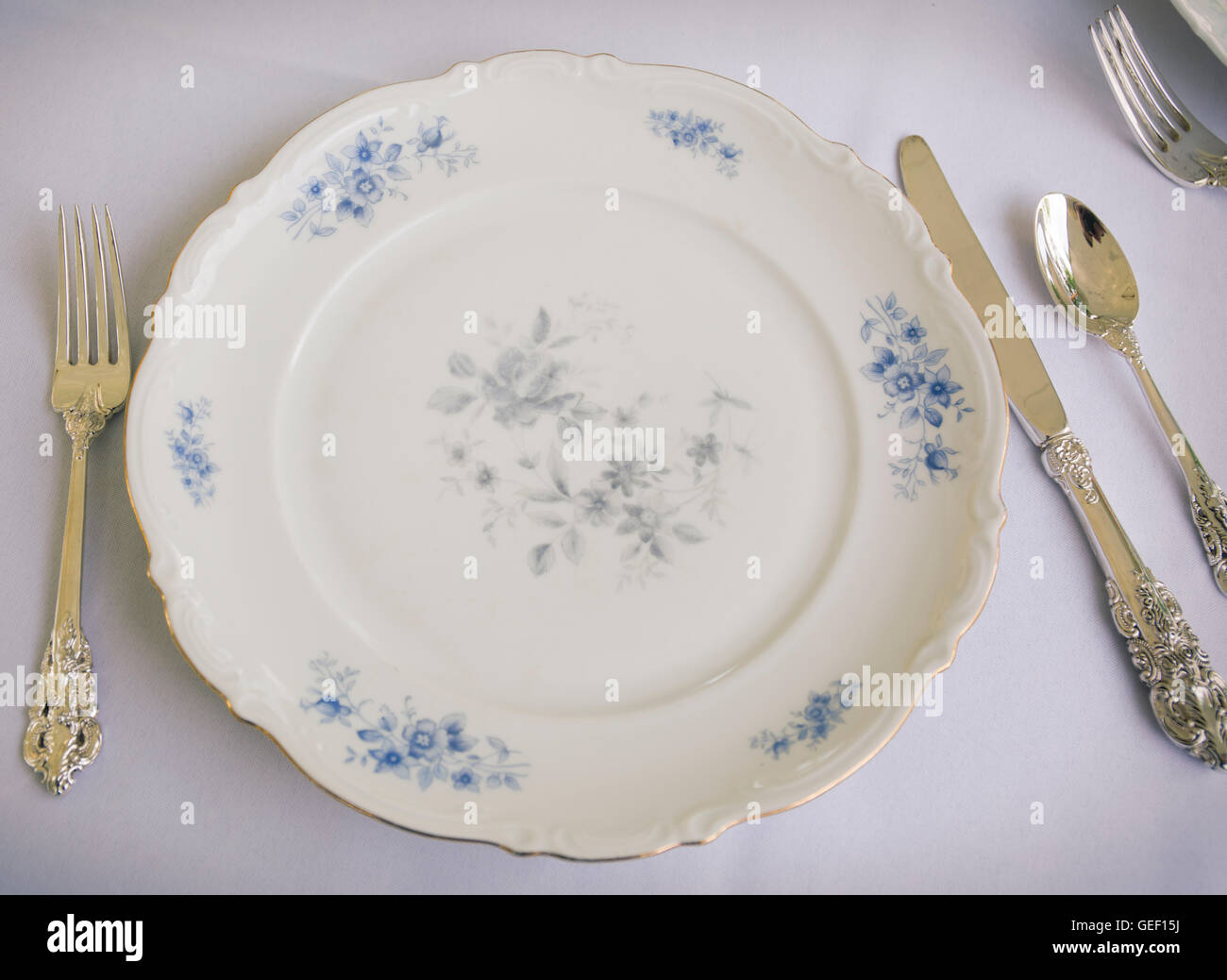 Table setting with fine china and silverware - Stock Image