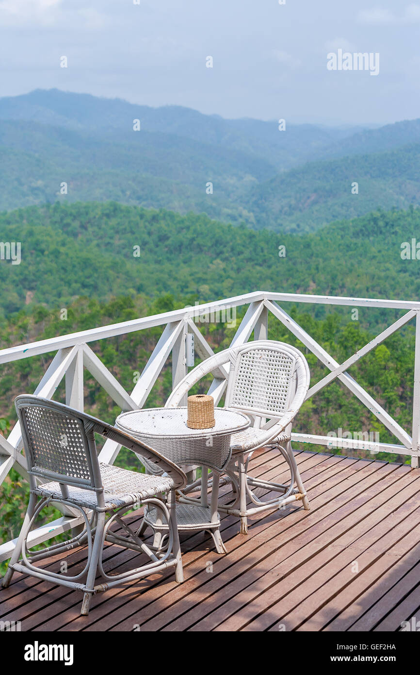 Rattan Chair On Balcony With Beautiful Mountain View Stock Photo
