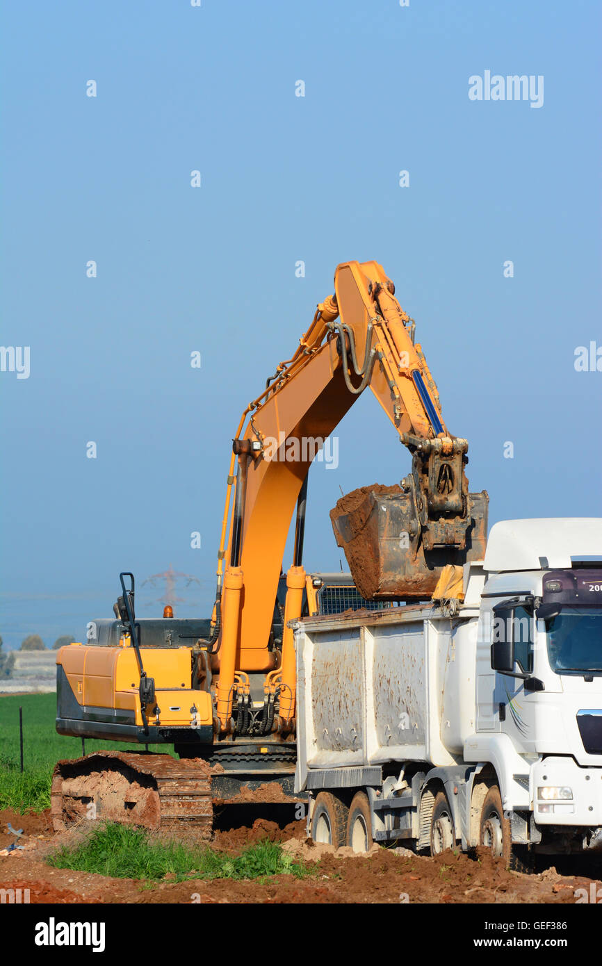 Earth Mover filling a truck - Stock Image