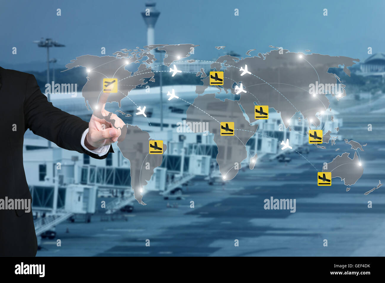 Businessman working with virtual interface to control connection networks of airplanes on their destination routes. - Stock Image