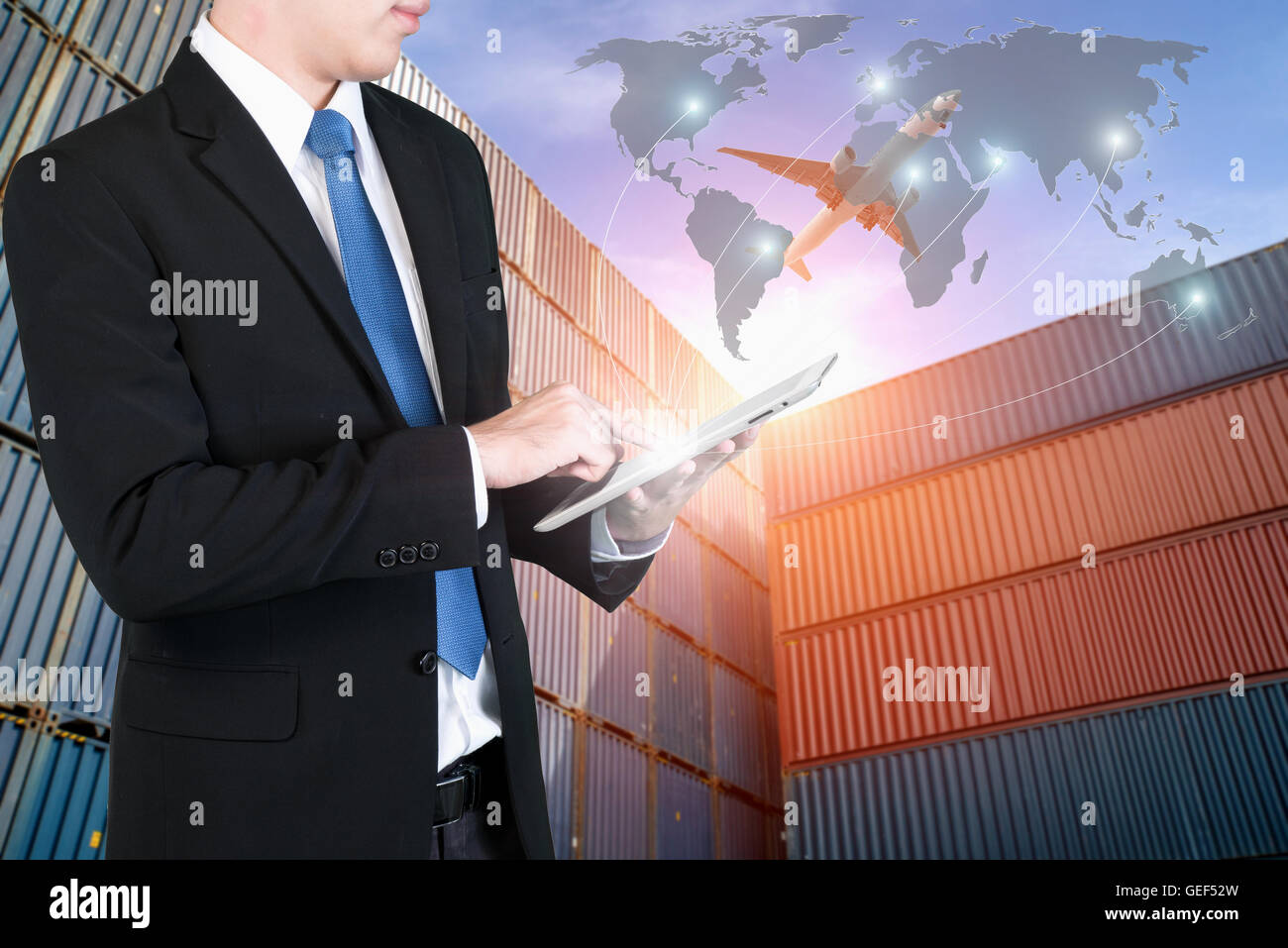 Businessman press digital tablet to show global network partnership connection use for logistic,import,export background. - Stock Image